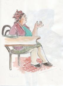 Une dame au café du marché